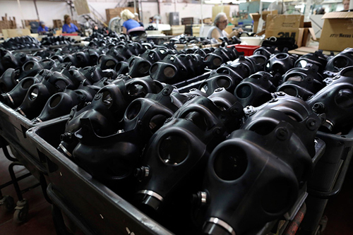 Israeli workers are seen at the Shalon gas mask factory in Kiryat Gat